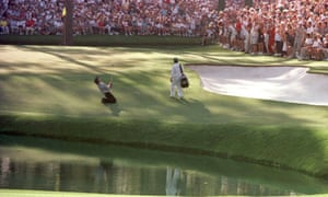 Greg Norman of Australia sinks to his knees on the 15th green after narrowly missing the hole with his chip shot.