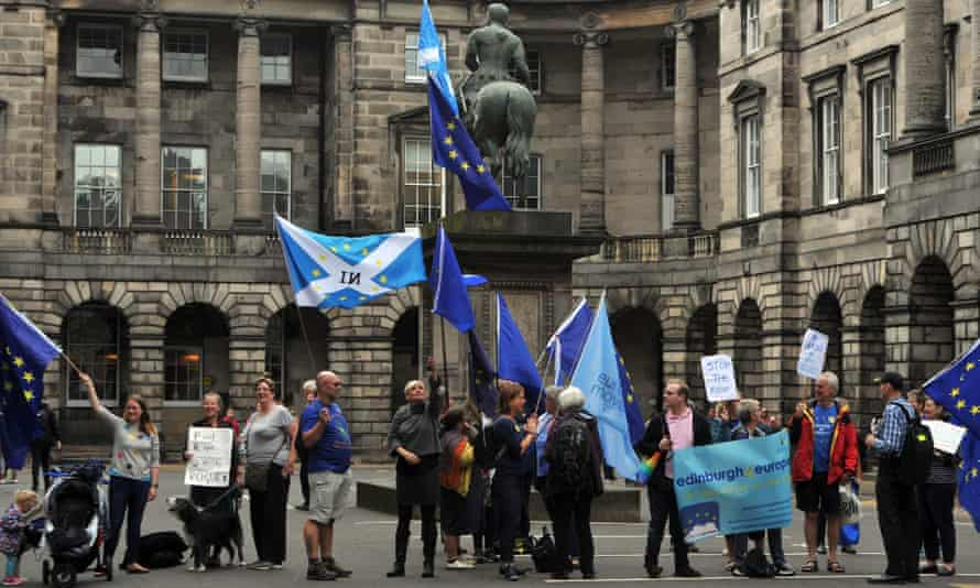 Protesters with EU and Scottish flags outside the court of session in Edinburgh