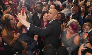 Booker takes photos after a campaign event in North Las Vegas.
