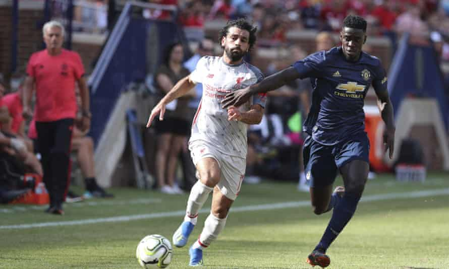 Mohamed Salah takes on Manchester United's Axel Tuanzebe during Liverpool's win