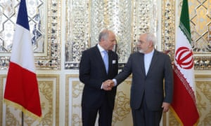 French foreign minister Laurent Fabius shakes hands with Mohammad Javad Zarif,  his Iranian counterpart, during a visit to Tehran in July.