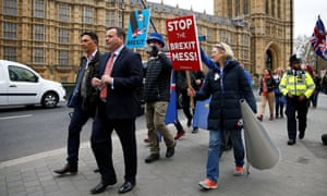 Arron Banks, co-founder of the Leave.EU campaign, walks past anti-Brexit protesters outside the Houses of Parliament