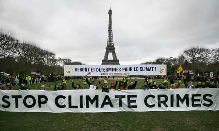 Activists demonstrate in front of the Eiffel Tower