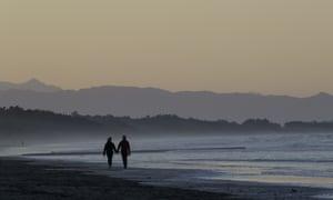 Couple walk on beach