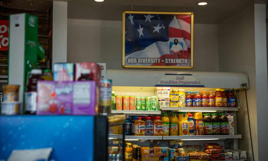 A photo illustration of Balbir Singh Sodhi transposed over a US flag in the Mesa Star food mart.