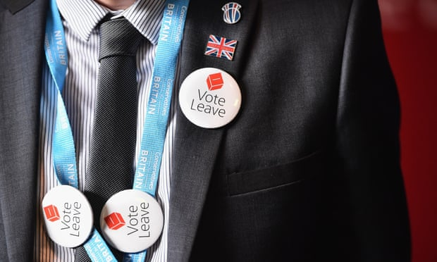 A man with vote leave EU badges.