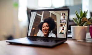 Shot of african businesswoman having a video call on a laptop with her team.