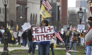 Rallygoers protest against Michigan governor Gretchen Whitmer's stay-at-home order, at the state Capitol Wednesday, April 15, 2020, in downtown Lansing.