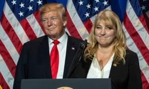 Donald Trump listens to realtor Teresa McKee.