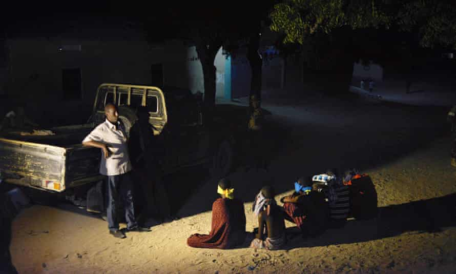 Somali security services stand guard over suspected al-Shabaab militants.