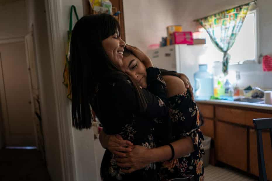 Karen hugs her mom in their kitchen on Mother's Day in Orange County, California.