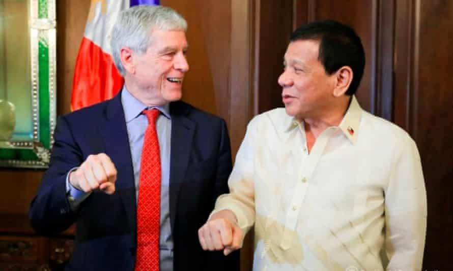 Nick Warner, the head of Australia's international spy agency Asis, performs a 'fist pump' gesture alongside the Philippines leader, Rodrigo Duterte, during a visit to Manila on Tuesday.