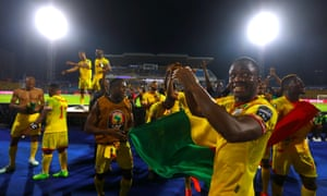 Benin players celebrate after the final whistle.