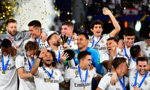 Real Madrid's players celebrate with the trophy after winning the FIFA Club World Cup final against Abu Dhabi's Al Ain.