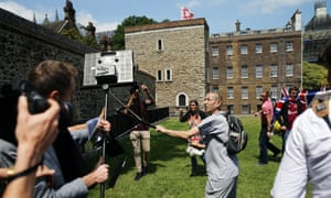 A protester confronts the media outside parliament after Tommy Robinson's sentencing for contempt.