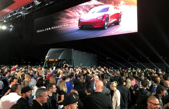 Elon Musk unveils Tesla electric truck – and a surprise new