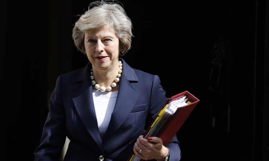 Theresa May with file