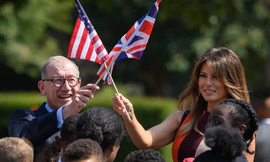 Philip May and Melania Trump hold their respective national flags at Royal Hospital Chelsea