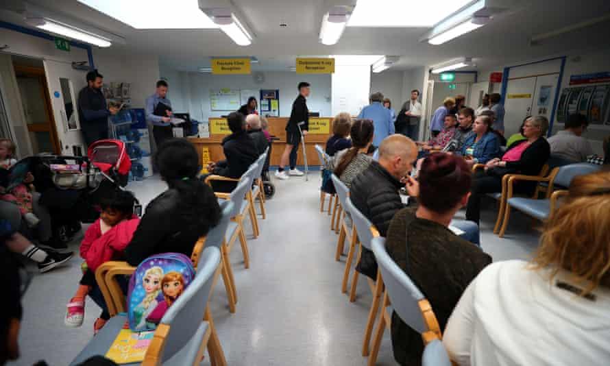People wait in the waiting room at Milton Keynes University Hospital