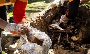An earth oven is dug up at Hyde Park in Sydney on Saturday, 13 July, as part of Naidoc week celebrations.