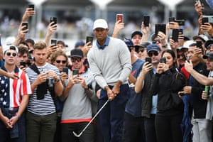 US player Tiger Woods chips onto the green during the second day of the Presidents Cup golf tournament in Melbourne, Australia