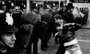 Police confront an anti-fascist protestor in Southall, April 1979.