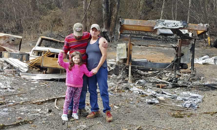 A family in Otis, Oregon, after a wildfire destroyed their home and nearly 300 others in September 2020.