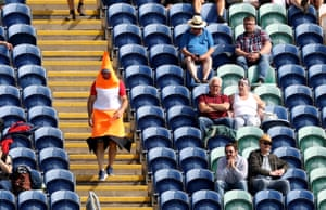 A traffic cone walks down the Fosters stand.