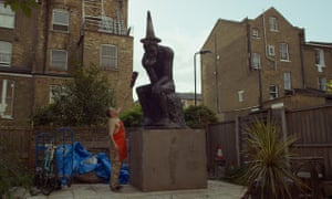 The Banksy Job: 'art terrorist' Andy Link with the street artist's statue.