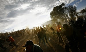 Ecuadorian natives clash with the police 30km from Quito in 2010 in protest of a proposed water privatisation measure.
