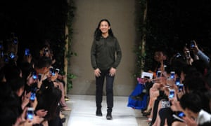 Former creative director Alexander Wang, takes a bow at the SS 14 Balenciaga show.