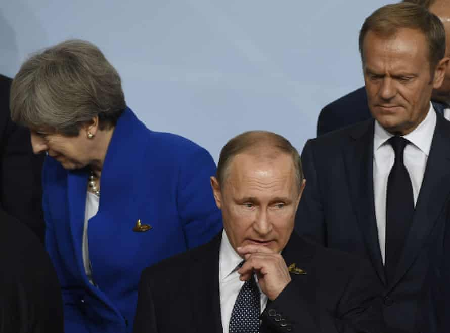 The former British PM Theresa May, the Russian president, Vladimir Putin, and Donald Tusk, who stepped down as president of the European Council this year, at the G20 summit in Hamburg last year.