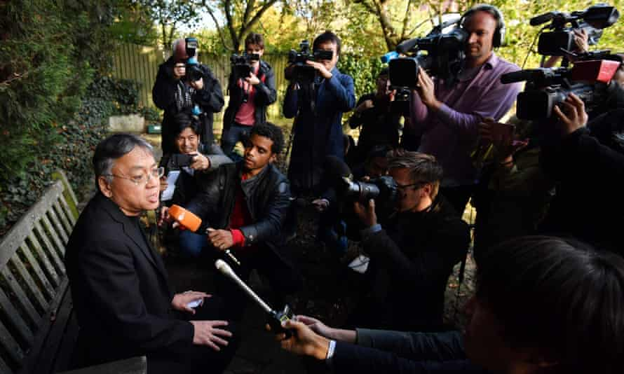 Ishiguro holds a press conference outside his London home after the win.
