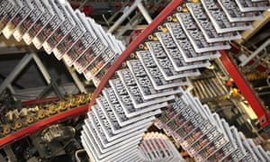 Copies of the Daily Mirror newspaper move along the production line at Trinity Mirror's factory.