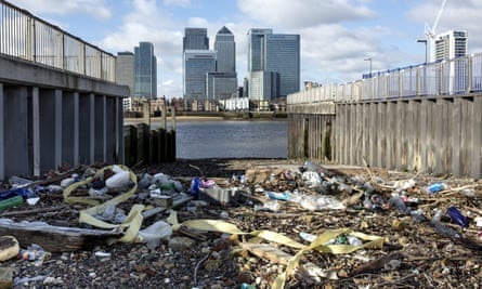 Plastic brought by high tides litters the high water line in front of Canary Wharf in London, UK. Pollution is one area highlighted by the pledge.