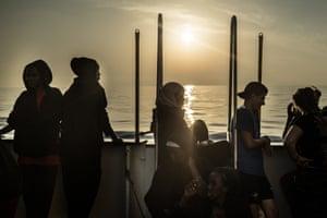 Rescued migrants onboard