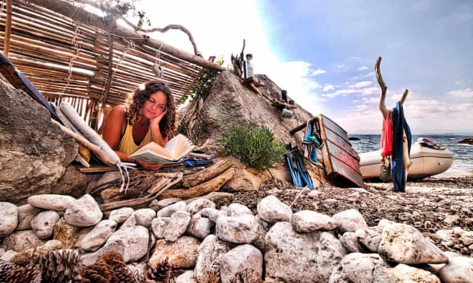 Susan reading in her beach den.