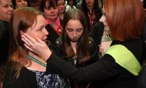 Former prime minister Julia Gillard comforts a young woman following the national apology