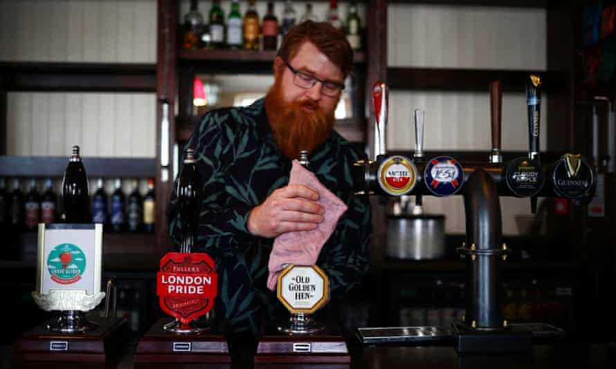 A landlord cleans his bar as pubs prepare to reopen.