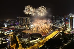 Fireworks explode over the esplanade and Marina Bay Sands in Singapore