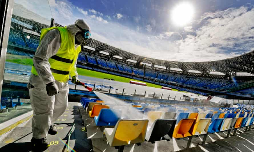 An worker sanitises the San Paolo stadium in Naples to prevent the dangers of contagion of Coronavirus.