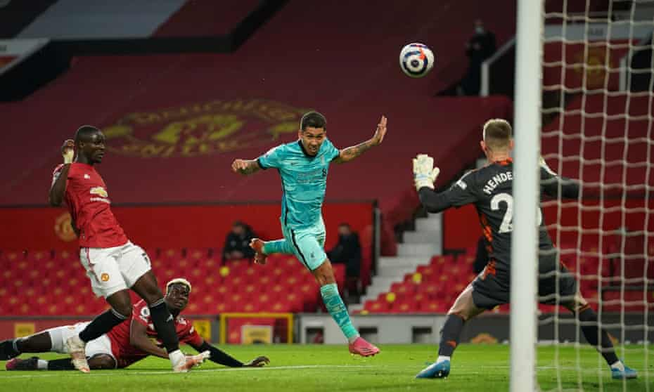 Roberto Firmino leads Liverpool's second goal beating Dean Henderson.