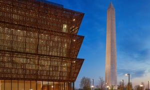The Smithsonian National Museum of African American History and Culture sits in the shadow of the Washington monument.
