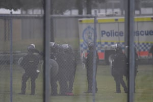 Riot police outside the detention centre.