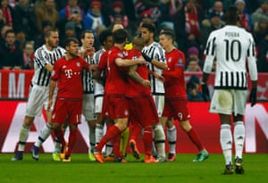 Bayern Munich's Arturo Vidal and Juventus' Juan Cuadrado argue