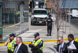 Police guard a damaged van in Toronto after it mounted a sidewalk and ploughed into pedestrians.