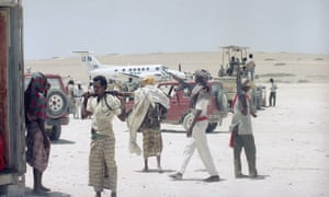 In the midst of Somalia's civil war in 1992, a UN relief plane arrives at Mogadishu airport with urgent medical supplies.