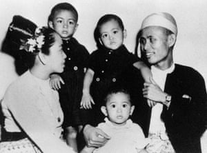 Aung San Suu Kyi, aged 2 (front C), Gen Aung San (far R), her mother Daw Khin Kyi (far L) and her older brothers