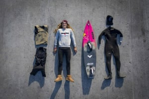 Dupont poses with her equipment: Airbag lifejacket, padded undersuit, surfboard with footstraps and wetsuit.