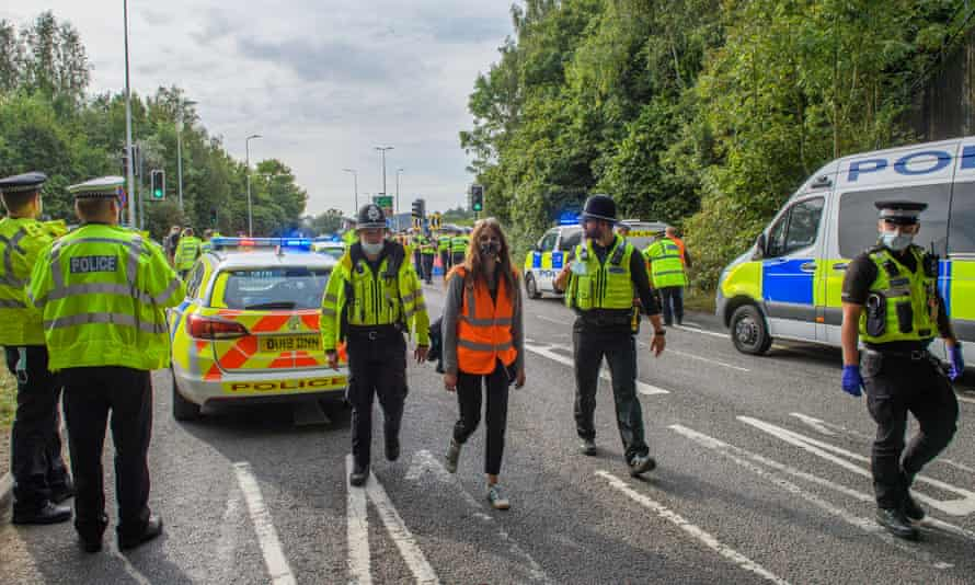 Police arrest a protester from Insulate Britain at the A41 roundabout at Junction 20 of the M25.